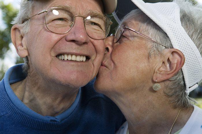 Wife kissing husband on the cheek