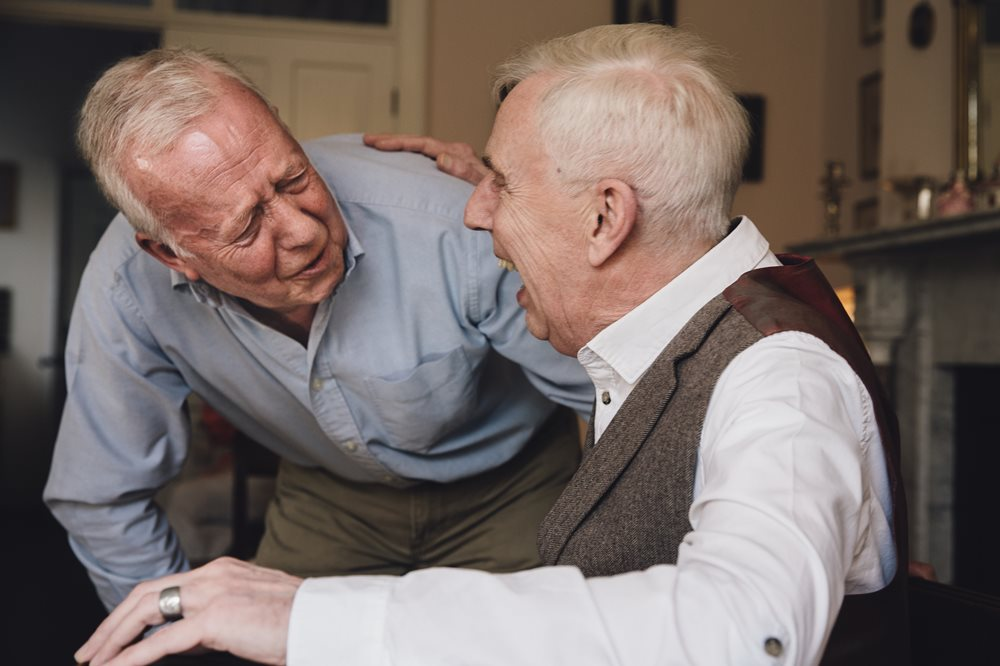 Two senior men laughing with each other