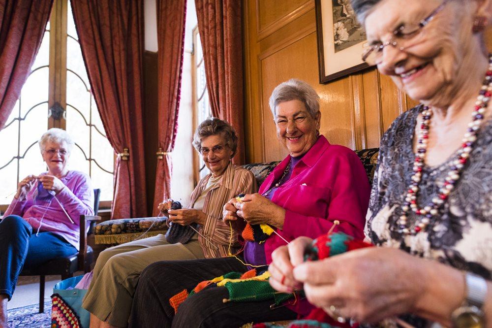 Senior women knitting together